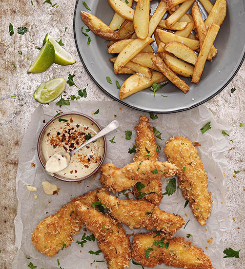 Parmesan crumbed chicken strips with potato wedges